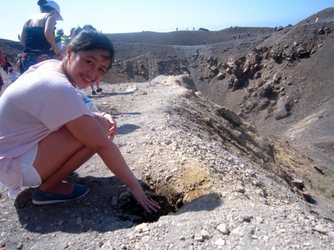 Mara getting a feel of Nea Kameni's sulfur vents