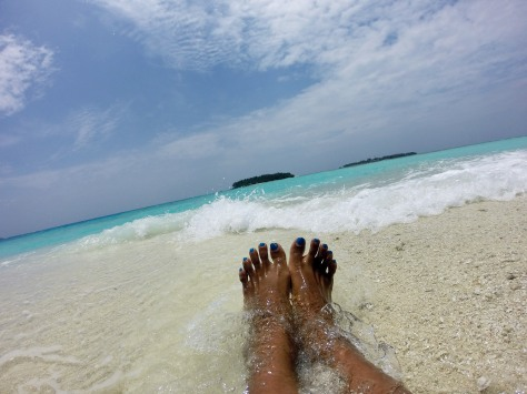 Happy feet atop a random sandbar in the middle of the Indian Ocean
